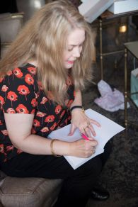 Donna signing books for the attendees and their guests